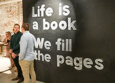 Writing on wall reads: Life is a book. We fill the pages.
